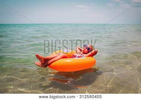 Cute Little Girl Swimming At Tropical Beach