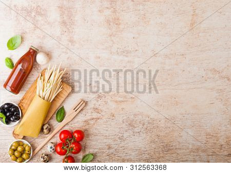 Homemade Spaghetti Pasta With Quail Eggs With Bottle Of Tomato Sauce On Wood Background. Classic Ita