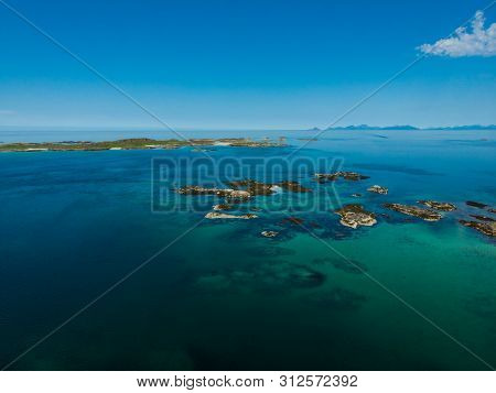 Coast Of Gimsoya Island In Summertime. Sea With Rocky Isles, Aerial View. Nordland County, Lofoten A