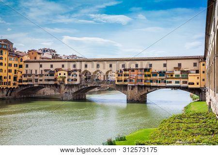 Ponte Vecchio a medieval stone closed-spandrel segmental arch bridge over the Arno River in Florence poster