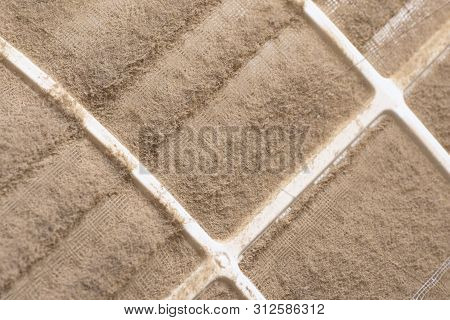 Closeup To Dust From Air Conditioner Filter Dirty