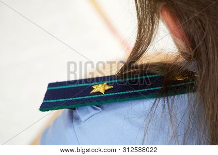 Shoulder Straps In The Russian Prosecutor's Office. The Girl Is A Junior Counselor Of Justice. Ranks