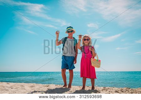 Happy Kids- Boy And Girl -travel On Tropical Beach