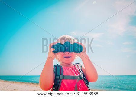 Little Girl With Backpack Travel On Beach, Kid Looking Through Binoculars