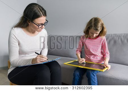 Professional Child Psychologist Talking With Child Girl In Office, Children Problems, Mental Profess