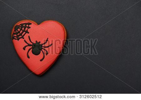 The Hand-made Eatable Gingerbread Heart With Spider On Black Background