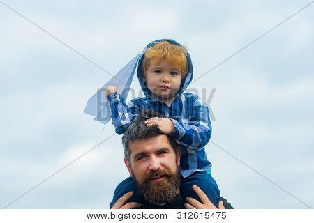 Father And Son Playing Together. Father And Son Enjoying Outdoor. Freedom To Dream - Joyful Boy Play