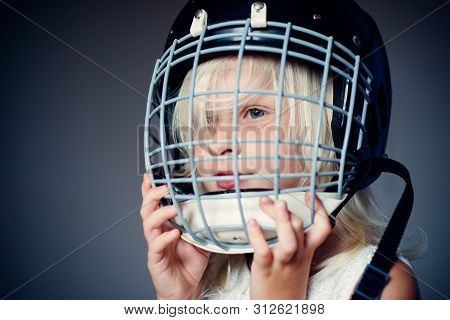 Girl Cute Child Wear Hockey Helmet Close Up. Safety And Protection. Protective Grid On Face. Sport E
