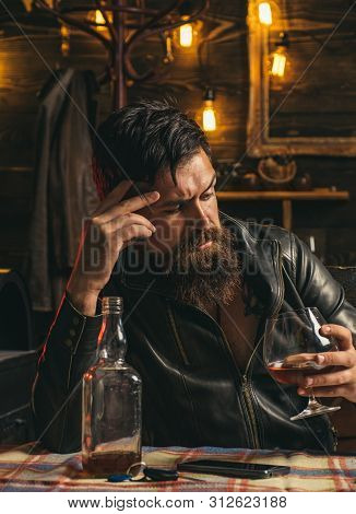 Drinking Man. Man With Beard Holds Glass Brandy. Man Holding A Glass Of Whisky. Sipping Whiskey. Deg