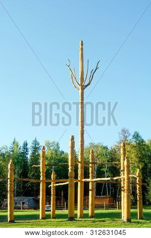 The religion of the Northern peoples of Yakutia - a symbol of the tree of life Al Luuk Mas stands wooden in the Park in the North of Russia in the forest in the Park in the village of ulus Suntar. poster
