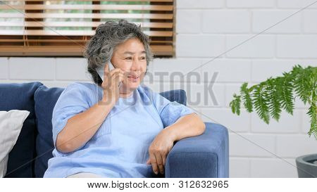 Senior Asian Woman Talking Phone While Sitting In Home Livivg Room, Asian Old Woman Call Phone With