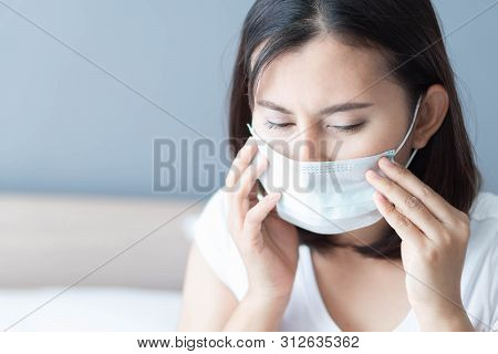 Close Up Sick Woman Wearing Medical Mask Face Lying On White Bed, Health Care And Concept