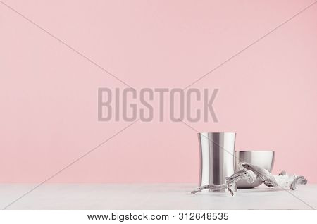 Fashioned Home Interior With Rounded Polished Steel Vases Different Form And Old Shabby Twig On Whit
