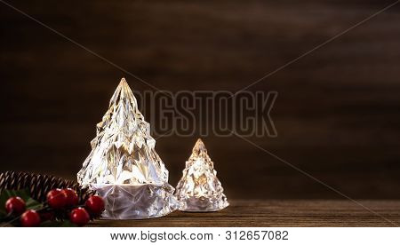 Modern Glass Christmas Tree With Lights On Dark Wood Table With Wall For Merry Chirstmas And New Yea