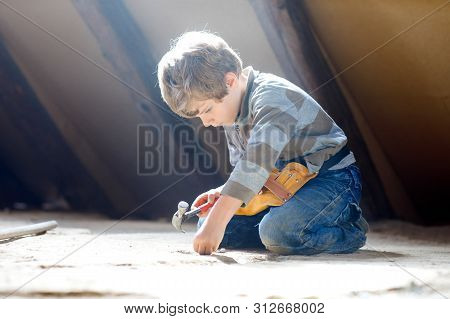 Little Kid Boy Helping With Toy Tools On Construction Site. Funny Child Of 6 Years Having Fun On Bui