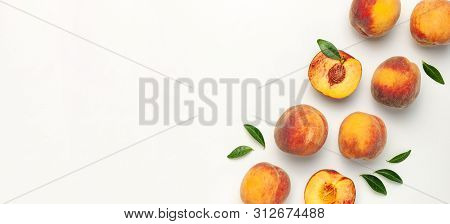 Flat Lay Composition With Peaches. Ripe Juicy Peaches With Green Leaves On White Background. Flat La