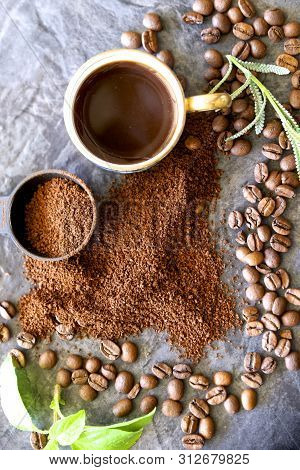 Cup Of Short Black Coffee In A Cup With Beans And Ground Coffee.