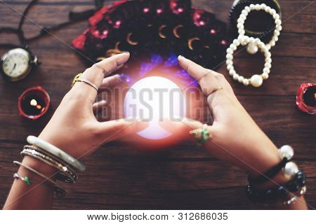 Psychic Readings And Clairvoyance Concept / Crystal Ball Fortune Teller Hands And Tarot Cards Readin