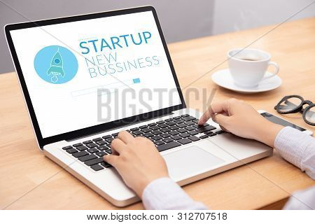 Business People Working On Notebook Laptop Computer With Startup Business And Rocket Logo On Screen,
