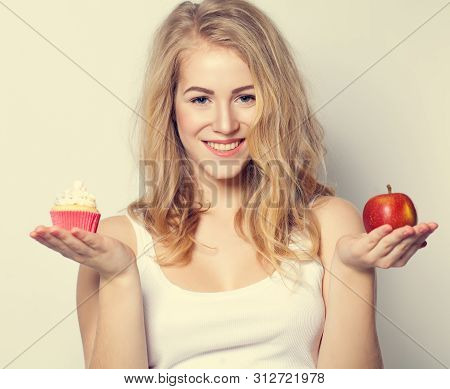 Smiling Beautiful Woman With Healthy And Unhealthy Food. Difficult Choice. Overweight Concept