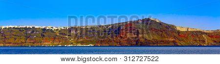 Santorini Island, Greece Panorama Banner Of Oia Village On Volcanic Rocks With Colorful Houses And B