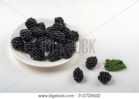 Blackberry Plate On White Background. Healthy Food For Breakfast