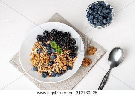Healthy Breakfast. Homemade Granola, Muesli, Cereals With Blackberries, Blueberries, Nuts, Honey And