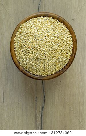 A Flat Lay Image Of A Bowl Of Quinoa On A Wooden Background Surface With Copy Space For Your Text