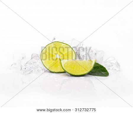 Fresh Lime Slice With Leaf ,ice On White Background