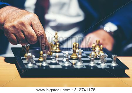 Close Up Hand Of Businessman Moving Chess Figure In Competition Success Play And Thinking For Manage