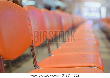 Close Up Row Of Blank Chairs In Seminar Room. Seats In An Empty Conference Room