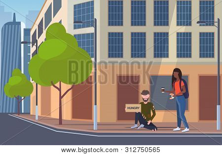 Woman Giving Food To Hungry Beggar Man Sitting On City Street With Sign Board Begging For Help Homel