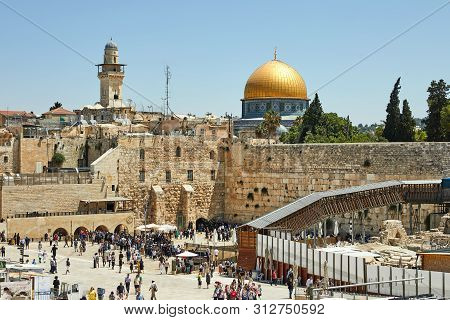 Jerusalem, Israel - July 10, 2019: View Of The Western Wall Of Jerusalem Wailing Wall And The Dome O