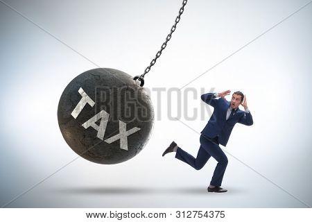 Businessman running away from high taxes