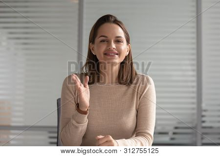 Smiling Businesswoman Talking Looking At Camera Skyping For Job Interview