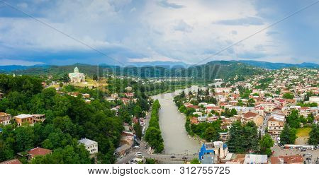 Panoramic Summer View Of The City Of Kutaisi, Georgia. Bagratis Cathedral And River Rioni And Old Ho