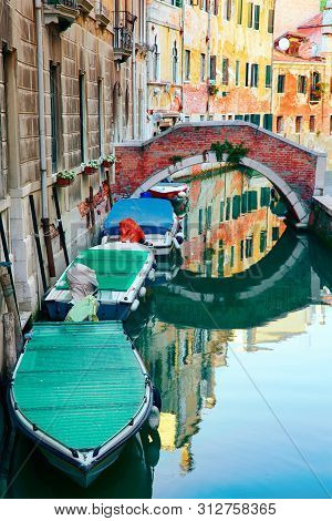 Canals Of Venice With Reflection In Water, Italy