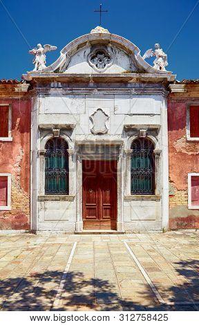 Old Catholic Church On Bressagio Street In Murano Island, Veneto, Italy