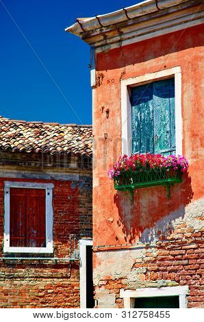 Murano Old Buildings And Closed Windows With Sun Blinds, Veneto, Italy