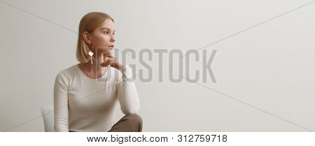 Fashionable Girl In A White Sweater And Checkered Pants . Natural Lifestyle Portrait Of Girl , Emoti