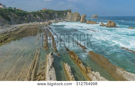 Summer, Cantabrian coastline landscape in costa quebrada, Arnia Beach, Coast of Liencres Cantabria, Spain