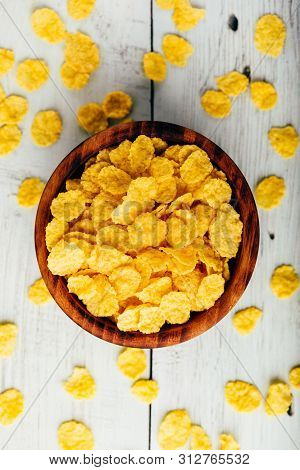 Breakfast Cornflakes In A Wooden Rustic Bowl. View From Above