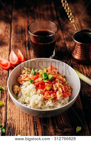 Scrambled Eggs With Tomatoes, Leek And White Rice. Turkish Coffee And Sliced Ingredients.