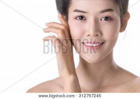 Beautiful Young Asian Woman With Cosmetic On Own Face. Cosmetologist, Skin Care Or Beauty Concept