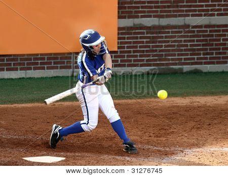 College Softball Player Swinging