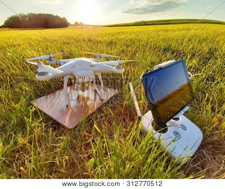 Pilsen / Czech Republic - June 16, 2019: Drone quadrocopter Dji Phantom 3 Professional with camera preparing to start. Take off for outdoor race. UAV in leisure activities.