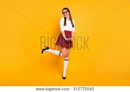 Full length body size view of her she nice attractive winsome lovely lovable cheerful cheery positive girl wearing uniform having fun isolated over bright vivid shine yellow background poster