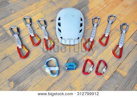 Top Down View Of Essential Sport Climbing Gear: Helmet, Belay Plate, Hms Carabiner, Screwgate Carabi
