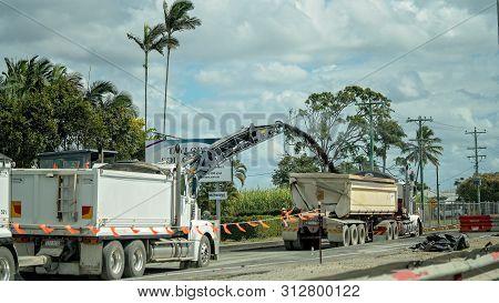 Mackay, Queensland, Australia - July 2019: Bitumen Being Sprayed Into A Trailer As Part Of Roadwork