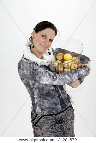 Cute Girl Standing With Apples